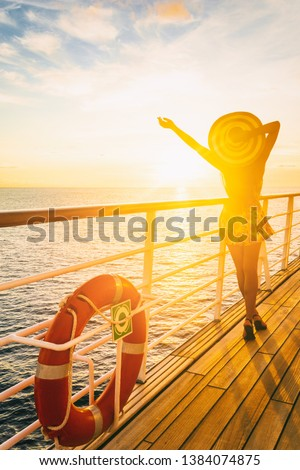 Cruise ship vacation woman enjoying travel vacation at sea. Free carefree happy girl looking at ocean with open arms in freedom pose. #1384074875