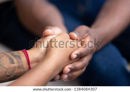 Black man friend holding hands of african woman, american family couple give psychological support, help trust care empathy hope in marriage relationships, comfort honesty concept, close up view #1384084307