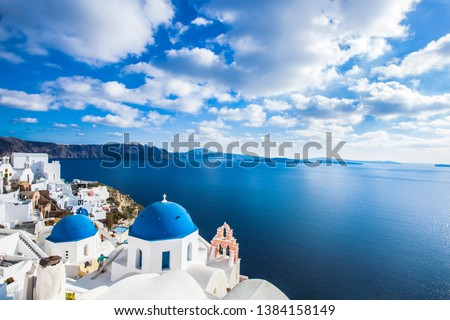 Famous blue domes of churches in Oia city on Santorini island, Greece #1384158149