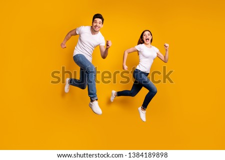 Full length side profile body size photo funky funny she her he him his guy lady jump high hurry shopping black friday low prices wear casual jeans denim white t-shirts isolated yellow background #1384189898