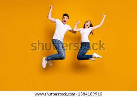 Full length side profile body size photo funky she her he him his pair jumping high yell scream shout best buddies lottery lucky goal wear casual jeans denim white t-shirts isolated yellow background