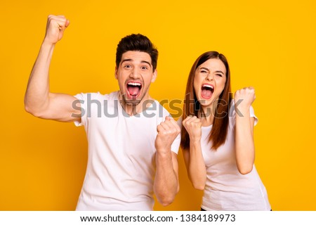 Portrait of two nice attractive lovely charming cheerful cheery people having fun lottery win winner best luck lucky isolated over vivid shine bright yellow background #1384189973