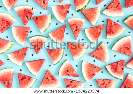 Watermelon pattern. Red watermelon on blue background. Summer concept. Flat lay, top view, copy space #1384223594