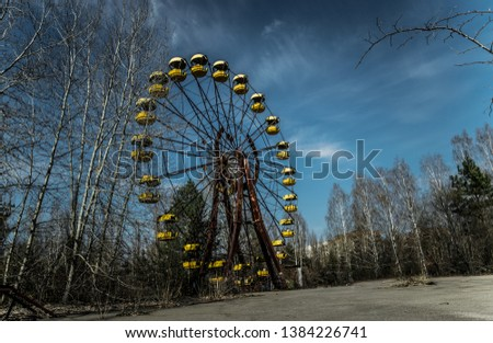 Old ferris wheel in the ghost town of Pripyat. Consequences of the accident at the Chernobil nuclear power plant #1384226741