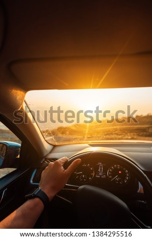 The road to success - a driver traveling on a road #1384295516