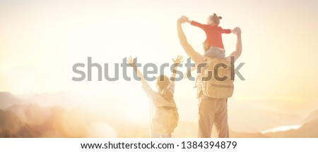 Happy loving family. Father and his daughters children playing and hugging outdoors. Cute little girls and daddy.  #1384394879