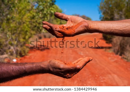 Aboriginal Australia, a landscape build on traditional values passed from many generations. The oldest live culture in the world. Red soil, black skin. The Australian outback #1384429946