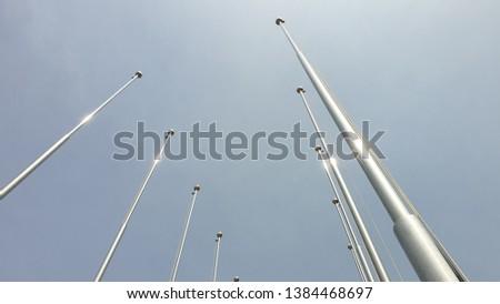 A flagpole toward the sky Royalty-Free Stock Photo #1384468697
