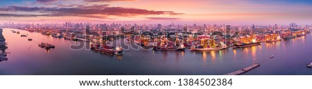 Aerial panoramic view of Logistics and transportation of Container Cargo ship and Cargo plane with working crane bridge in shipyard at sunrise, logistic import export and transport industry background #1384502384