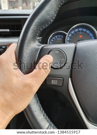 Hand adjusting sound in the car #1384515917
