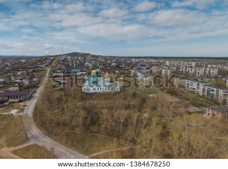 Church in Polevskoy city, Aerial, spring, cloudy #1384678250