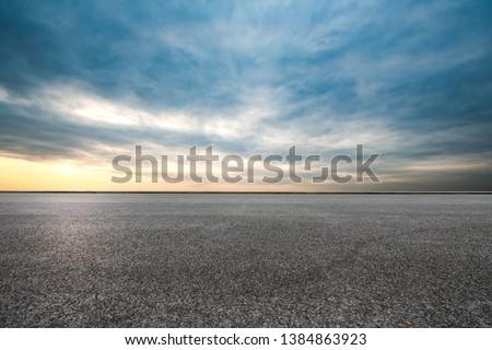 An empty asphalt highway at sunset #1384863923