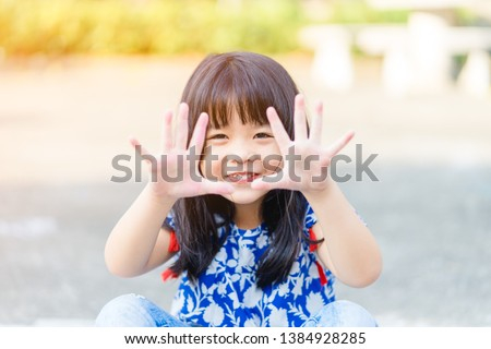 child washing hands and showing dirty hands at playground.Hand foot and mouth disease in child concept. #1384928285