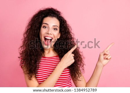 Close-up portrait of her she nice-looking attractive charming cute adorable shine cheerful cheery wavy-haired girl pointing aside isolated over pink pastel background #1384952789