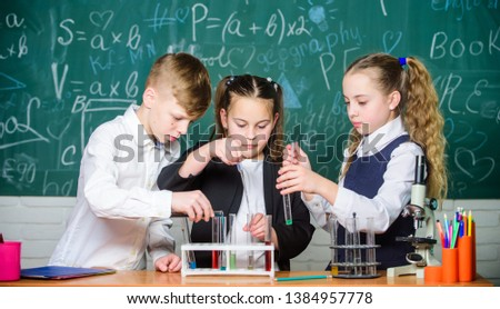 Little kids learn chemistry in school lab. students do biology experiments with microscope. Lab microscope. childrens day. Chemistry microscope. Little children at laboratory. Inspired to work hard. #1384957778