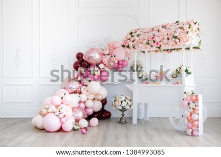 Cake stand with pink cake flowerpots, geometric flower holder, cup cakes, and balloon cascade #1384993085