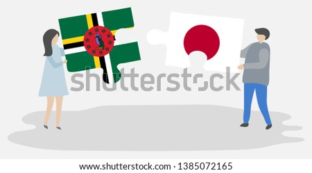 Couple holding two puzzles pieces with Dominican and Japanese flags. Dominica and Japan national symbols together. #1385072165