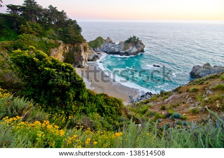 McWay Falls at Julia Pfeiffer Burns State Park in California is one of the few waterfalls in the world that falls directly into the ocean. #138514508