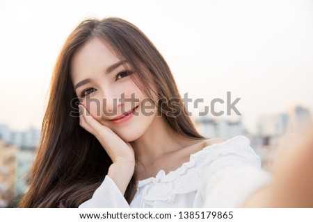Portrait of young beautiful asian woman  using smart phone selfie live in roof top. Happy asian girl online influencer blogger. Education technology connected asia people, woman lifestyle concept #1385179865