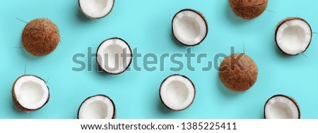 Pattern with ripe coconuts on blue background. Pop art design, creative summer concept. Banner. Half of coconut in minimal flat lay style #1385225411