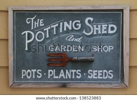 Old weathered sign of a potting shed.