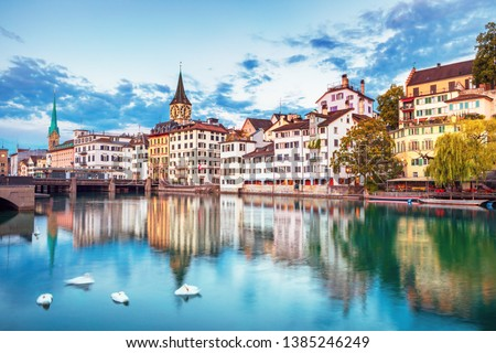 Scenic view of historic Zurich city center with famous Fraumunster and Grossmunster Churches and river Limmat at Lake Zurich, Canton of Zurich, Switzerland #1385246249