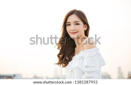 Portrait of young beautiful innocence asian woman in sky roof top. Smile face asian girl wear casual cloth. Beauty treatment perfect clear skin japanese makeup asia woman lifestyle concept  #1385287955
