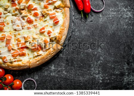 Pizza with chicken and cheese sauce. On dark rustic background #1385339441