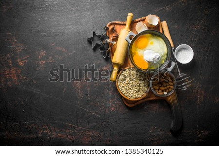 Baking background. Preparation of homemade cookies. On dark rustic background #1385340125