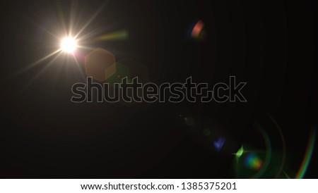 Lens flare effect on black background. Digital colorful illustration. #1385375201