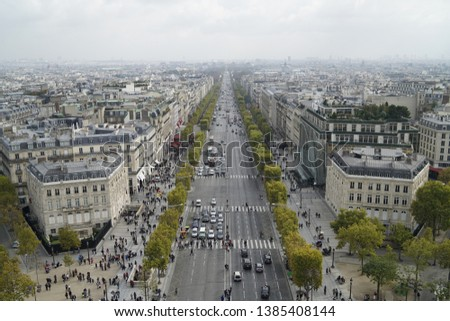 Looking down Paris on the top of Arc de Triomphe #1385408144