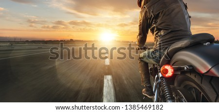 Motorcycle driver riding alone on asphalt motorway. Outdoor photography. Travel and sport, speed and freedom concept #1385469182