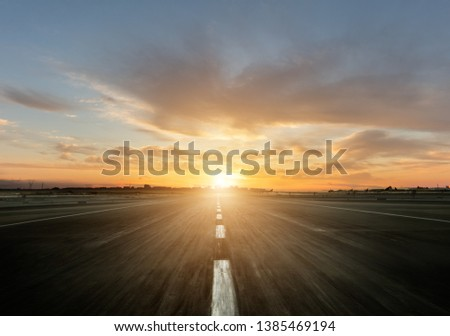 Empty motorway with sunset. Outdoor photography. Travel and sport, speed and freedom concept #1385469194