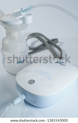 Kuching, Malaysia - April 2019. Phillips Avent electronic breast pump isolated against white background #1385543000