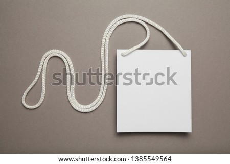 Clip pass on gray background, identification tag. Copy space. #1385549564
