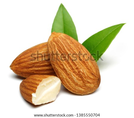 Group of almonds with leaves isolated on white background #1385550704