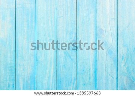 Wood blue color plank background with soft light well use editing display product and text on free space wall texture background,top view