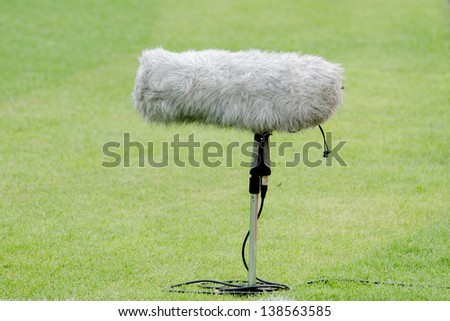 A large microphone boom for tv or radio situated at a football match.