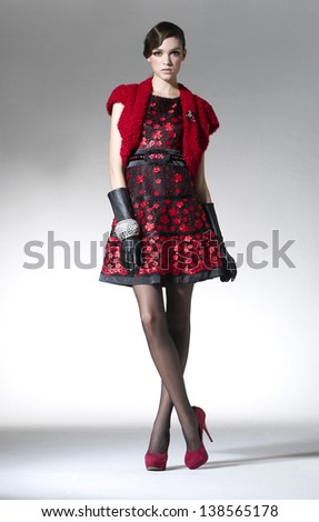Fashion model Posed on light background in fashion dress #138565178