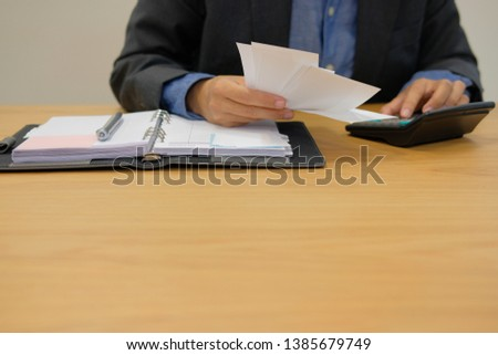 man calculate domestic bills. Businessman using calculator checking balance & costs. Startup counting finance for paying taxes at office #1385679749