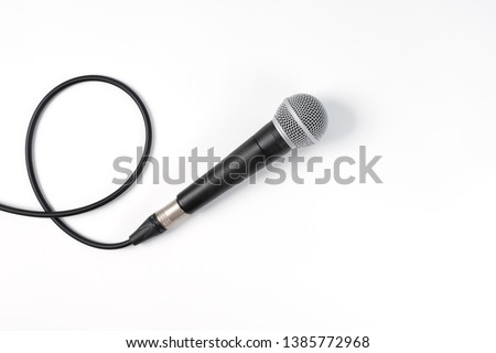 Close up of high quality dynamic microphone connect with male xlr connector and  cable isolated on white background,top view. High fidelity microphone on white background with clipping path .  #1385772968