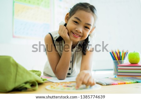 Asian cute little child girl drawing at home #1385774639