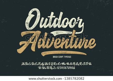 """Outdoor Adventure"". Vintage Brush Script Modern Alphabet. Retro Font. Vector Illustration.  Royalty-Free Stock Photo #1385782082"