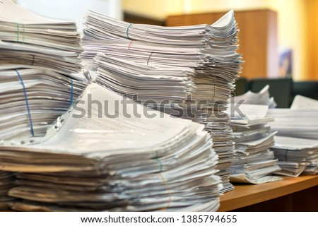 bundles bales of paper documents. stacks packs pile on the desk in the office #1385794655