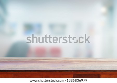 Empty wooden table and interior background, used for montage or display your products #1385836979