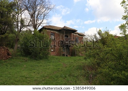 Old ruined house adobe and wood facade in village Gara Bov, Bulgaria. Old adobe wall. Brown, detail. #1385849006