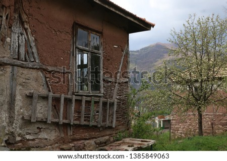 Old ruined house adobe and wood facade in village Gara Bov, Bulgaria. Old adobe wall. Brown, detail. #1385849063