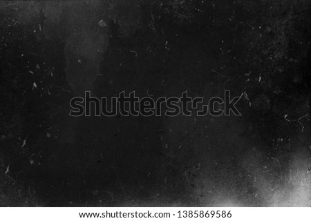 Black grunge scratched background, obsolete scary texture, old film effect, copy space #1385869586