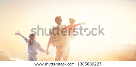 Happy loving family. Father and his daughters children playing and hugging outdoors. Cute little girls and daddy.  #1385880227
