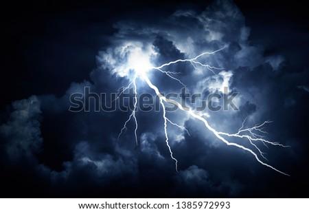 Lightning strike on the cloudy dark sky. Royalty-Free Stock Photo #1385972993